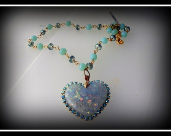 Heart necklace with handmade rosary chain surrounded by rhinestone bucket chain
