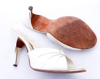 Sexpot Spring-o-lator spike heel mules by Capendo in luscious pearly white, excellent condition.
