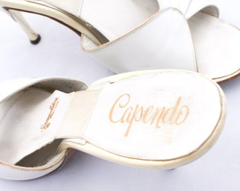 Price reduced! Stunning 1950s Capendo Spring-o-lator spike heel mules in luscious pearly white, excellent condition.