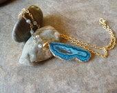 Blue geode slice pendant.