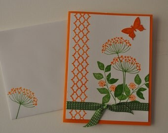Hand Stamped all occasion card, orange flowers, green ribbon and punched butterfly