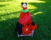 Watermelon doll on a stick