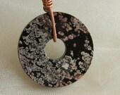 Black coral donut pendant w leather cord , fossilized black coral w lacy flowers , coral donut jewelry , round pendant , unusual jewelry