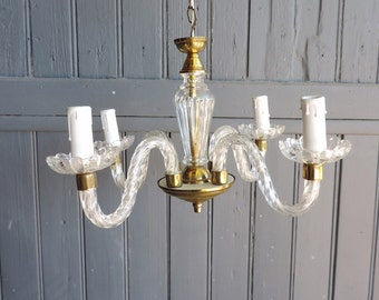 A four lamp, mid century, vintage french chandelier in lucite, glass, and brass