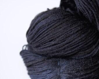 "Hand Dyed Yarn Superwash Merino . DK . 243 yards . ""Midnight"" . Shades of black and blue"