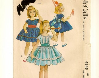 "A Wide Back-Tie Sash, Short Sleeve, Back Button, Full Gathered Skirted Party Dress Pattern: Children's Size 3, Breast 22"" • McCall's 4345"
