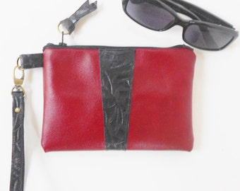 Red leather wristlet.