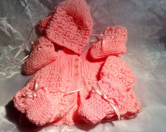 Pink knitted baby outfit