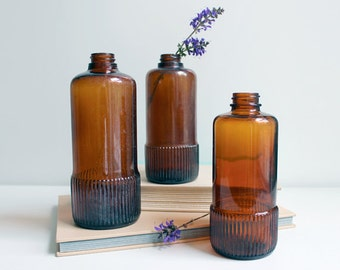 Set of Three Amber Bottles with Embossing