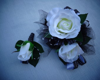 2 Piece wrist corsage and boutonniere in white roses with black-silver ribbon