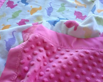 Sale, i took 5 dollars off this Beautiful cuddly pink and tossed animal print . With pink minky dot and matching satin ruffle