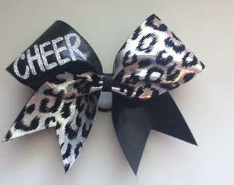 Cheer cheetah cheer bow. Ask about bulk discounts, color and mascot options.