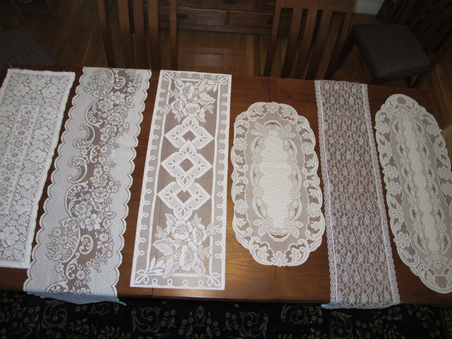 assorted vintage lace wedding table runners by weddingparties