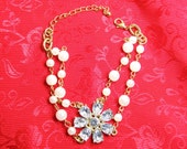 Faux Pearl Bracelet with Clear Rhinestone Flower