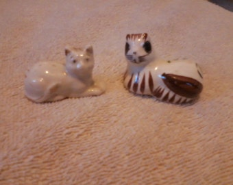 "Two Small Ceramic Cat Statues about 1"" x 3/4"". Very Cute"