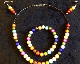 Light reflective necklace, bracelet and earring set.