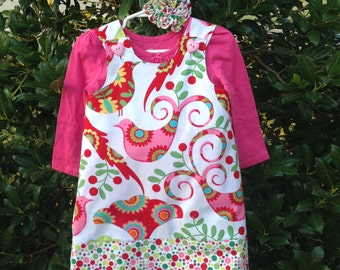 A Partridge in a Pear Tree Christmas Holiday Dress, Jumper, Pink, Red (infant, baby, girl, toddler,child) with matching hair accessory.
