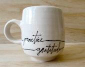 "Black and White ""Practice Gratitude"" Mug. Word mug. Graphic. Minimal. Porcelain mug. Modern kitchen. Gift. Affirmation mug. MADE TO ORDER."