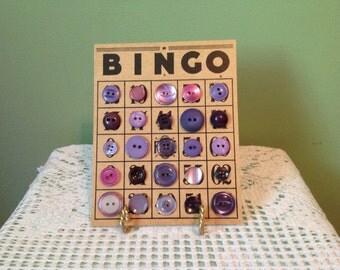 Vintage Bingo Card embellished with purple buttons.