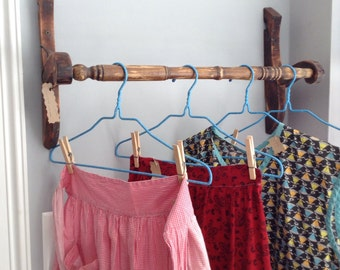 Towel rack made from parts of an old wooden kitchen chair.