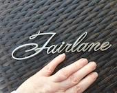 Ford FAIRLANE car emblem
