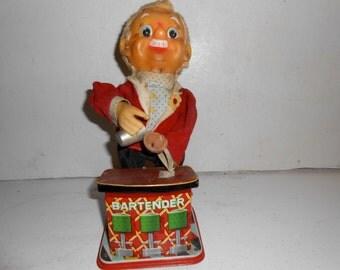 vintage tin bartender toy