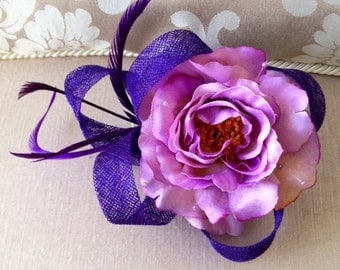 Gorgeous purple flowered fascinator with feathers and sinamay loops
