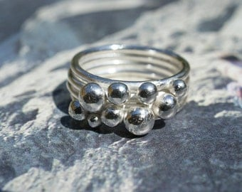 Handmade sterling silver four band ring with random silver balls