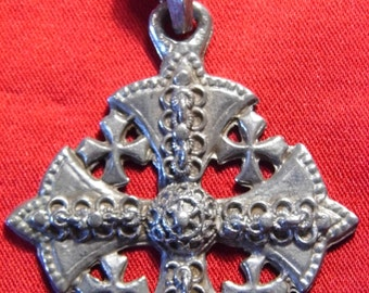 A vintage pewter celtic cross pendant with decoration on both sides