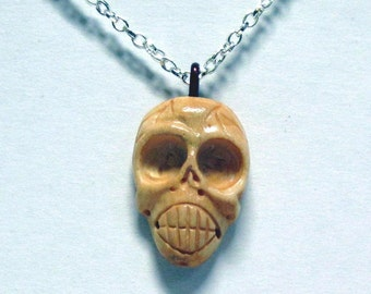 Hand Carved Bone Skull on a Silver Colored Chain Necklace  08