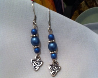 Blue and sterling silver pierced earrings with Celtic knot charms.