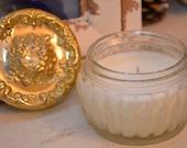 Candle in a vintage powder jar