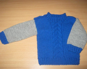 Warm knitted sweater for boy.