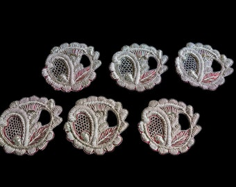 Intricately Decorated Ivory and Red Scroll Appliques