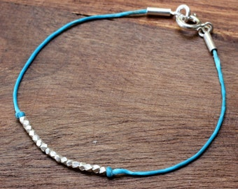 Waxed cotton bracelet with sterling silver beads
