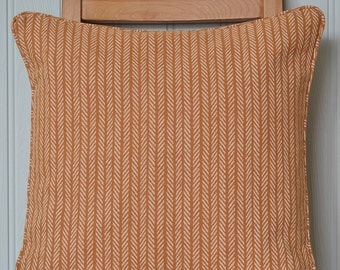 Orange and white striped linen cushion cover with piping