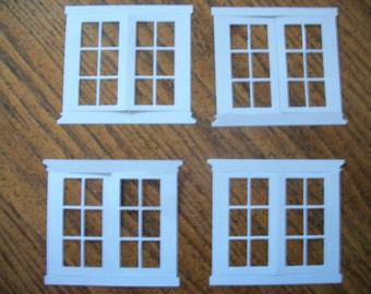 4 white die cut windows.