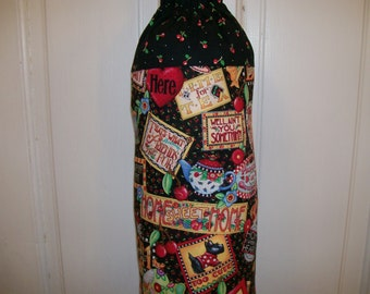 "30"" tall Plastic Bag Holder in mostly black, red, green, yellow, orange, and blue colors.  Made from 100% cotton fabric."
