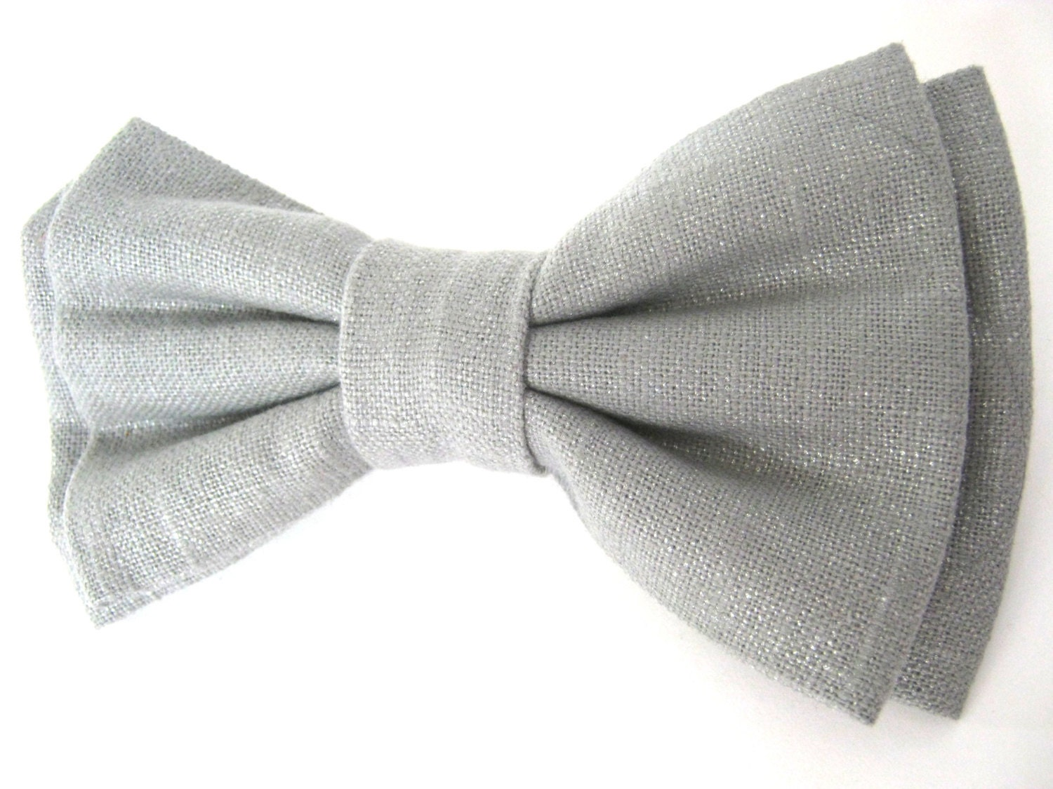 silver metallic bow tie stacked attaches to the