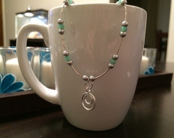 handmade silver, grey, and mint necklace with hill tribe pendant