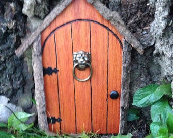 Gnome door, fairy door, or tree door with lion knocker