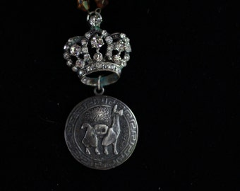 Unusual llama pendant necklace with crown