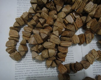 Side cut pointed nugget beads, coconut wood beads, about 10X25mm, 30 beads