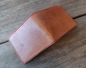 Handmade leather wallet shown in rustic natural tone