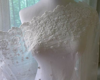 Graceful embroidered floral tulle lace fabric in off white for bridal, dress, cuffs, costume design