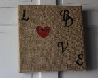 Initial LOVE burlap painting.
