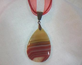 PAY IT FORWARD - Teardrop shaped red-orange striped druzy geode pendant (JO54)