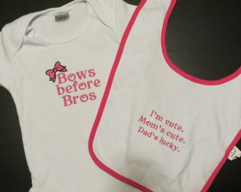Embroidered girl's onesie and bib set
