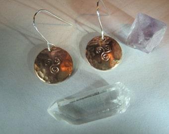 triskele, triple spiral earring in copper