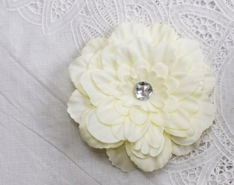 cream colored Flowered hair clip with jewel center